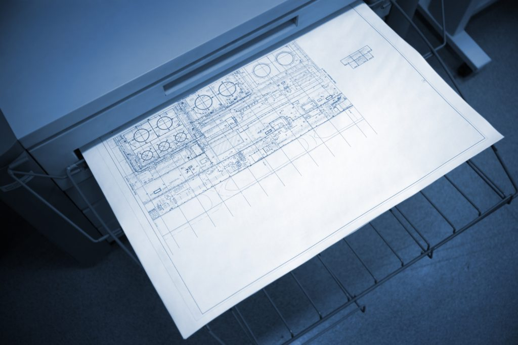 A wide format printer in action.